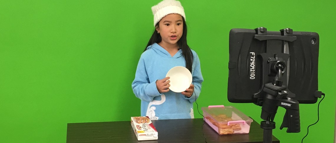 Murdy students utilize green screen technology to create videos.